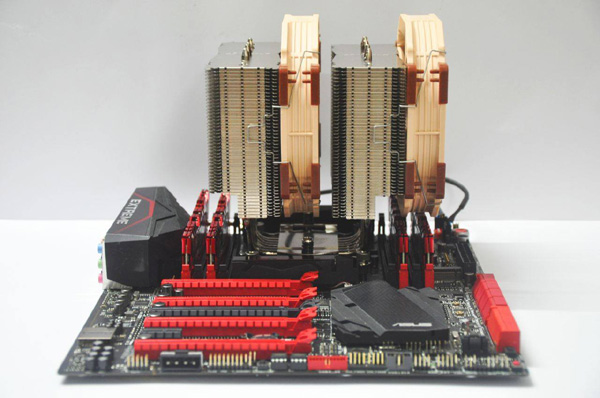 Red and Black motherboard? You guessed it. ASUS Rampage Extreme motherboard that fits seamlessly with the G.Skill RipJaws and massive Noctua CPU cooler. Just perfect.
